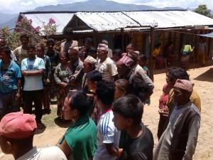 Nepal villagers receiving relief supplies