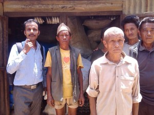 Sanjay with villagers in Nepal at the distribution of relief supplies