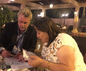 Pastor's wife and I going over the records for the Iraqi Refugee fund.