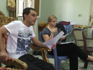 Explaining the policies of the program with Youssef translating