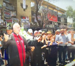 A dear Brother, an Iraqi Pastor praying at the scene of the July 4 Karrada bombing