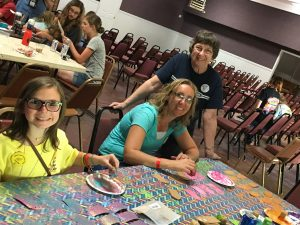 Linda Iles and helpers at the Awana Camp craft table
